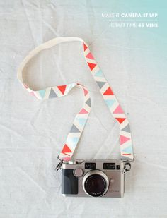 DIY camera strap-  • 2 yds cotton webbing (we used 1 1/2 inch natural cotton) • masking tape • acrylic craft paint • 2 swivel hooks (found in the jewelry or with purse handle section of most craft stores) • fabric glue • needle and thread