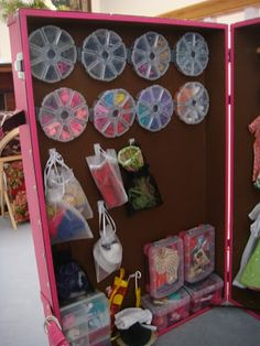 Genius for barbie shoes and boots!!The shoes are in the round plastic holders that are usually used for beads.  The plastic bins hold accessories and a larger bead box accommodates boots.  Hats are hung in jewelry bags using Command hooks.