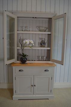 The Robert dresser is the smaller version of the Adam dresser. It is available with either a glazed top (as pictured) or with open shelves. www.jamesbrindley.com, for more details.