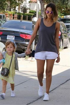 Jessica Alba wearing Chanel Reissue 2.55 Bag, Supra Belmont Sneakers and Michael Stars Eyelet Shorts in White