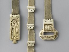 Belt with ivory buckle, pendant and stops (ceinture). A 15th century belt of an abbess. Grey wool belt, with ivory fittings. (C) RMN-Grand Palais (musée de Cluny - musée national du Moyen-Âge) / Jean-Gilles Berizzi.