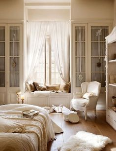 Really beautiful white and cream color palette room! So bright and calm and airy- love it!