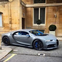 Bugatti Chiron painted in Gray w/ Blue accents and exposed carbon fiber    Photo taken by: @cjsautomotive on Instagram     Owned by: @khk on Instagram