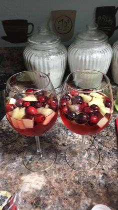 White wine, cranberries, apples, apple cran juice, & sprite