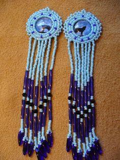 Blue rosette beaded Howling wolf earrings on Wanelo