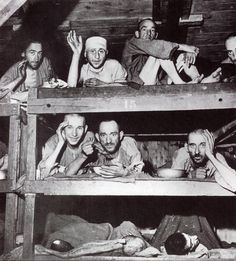 buchenwald survivors eating in bunk