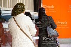 Two Women Are Standing With Their Backs royalty-free stock photo