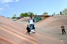 A playscape doesn't have to be a separate plot of ground. Julian de Smet Architects turned the roof of a boat storage facility into a skating and sliding landscape for play.Image courtesy of JDS Archtects. Boat Storage, Truck Storage, Youth Center, White Concrete, Wooden Decks, Copenhagen Denmark, Interior Exterior, How To Run Faster, Location