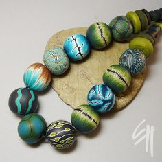 Bead Necklace by E.H.design, via Flickr -bottom green and black bead.