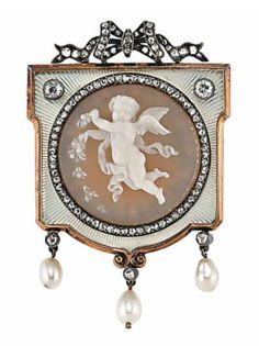 AN EARLY 20TH CENTURY CAMEO BROOCH  The central circular agate cameo depicting a cherub scattering petals, to a rose-cut diamond border and white guilloché enamel frame further set with two old-cut diamond highlights, with a rose-cut diamond bow deisgn surmount, and suspending three pearl and diamond drops, circa 1900, Russian marks for gold, 4.7cm long