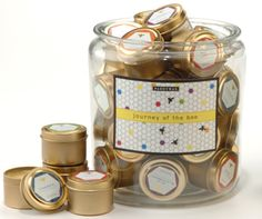 orange blossom candle favor in gold packaging by paddywax.