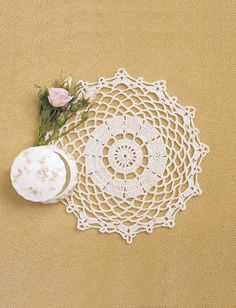 Create a lovely lace doily with this intermediate crochet pattern to add a fancy touch to your dining room table. The Pretty Crochet Doily Pattern from Bernat Yarns uses a small 2 crochet hook mm) and light cotton yarn to form the delicate desi Free Crochet Doily Patterns, Crochet Patterns For Beginners, Crochet Motif, Knitting Patterns Free, Free Knitting, Beginner Crochet, Free Pattern, Crochet Ideas, Crocheting Patterns