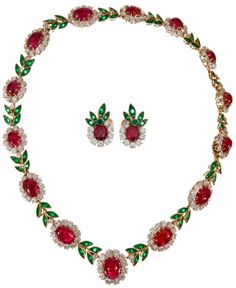 Van Cleef & Arpels Convertible Suite. Museum-worthy Van Cleef & Arpels necklace and earrings suite decorated with flowers made of gemstones: cabochon rubies, brilliant diamonds and intense green emeralds form a garland of lifelike and dazzling flowers.  The necklace comes apart and splits into a set of two bracelets.  Via 1stdibs.