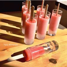 STRAWBERRY DAIQUIRI ICE POPS Strawberries 4 oz (120ml) Rum 1 oz (30ml) Cointreau 1 1/2 (45ml) Orange Juice 1/2 Cup Sugar  Blend Freeze