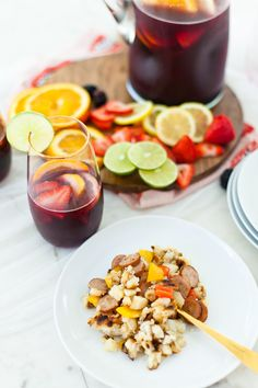 What better way to celebrate the season than with a blood orange berry summer sangria? Its our go-to summer drink and with one big hack to make sangria even easier, this recipe is perfect for your next gathering or summer get together! - Refreshing Blood Orange Berry Summer Sangria Recipe featured by popular Florida lifestyle blogger, Tabitha Blue of Fresh Mommy Blog
