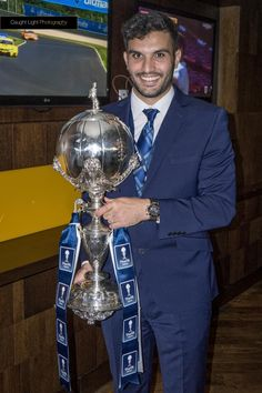 Hamza Bencheriff of Halifax Town holding the FA Trophy