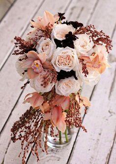Blush, Cream, Peach wedding centerpiece flowers. Pretty!