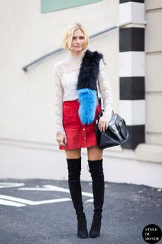Street Style Trend: Fur Accessories - bright black and blue fur scarf, worn with a lace top, bright red mini skirt + thigh high boots