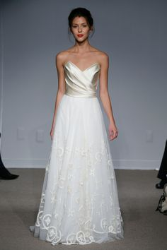 After checking out Glamour favorites, Alzuro Video Production (AVP) selected the dresses we thought were worthy of your time from the Fall 2013 Bridal Market. These dresses are gorgeous and should inspire any fall wedding!