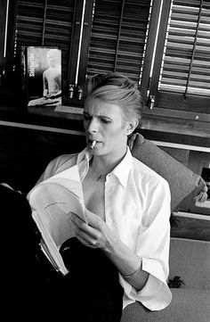 In his dressing room English musician and actor David Bowie reads a script during a break in filming 'The Man Who Fell to Earth' New Mexico 1975