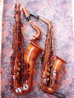 Lovely saxophones, unique Alto sax and Tenor sax pair, on a pink and purple background. Saxophone Instrument, Tenor Sax, Violin, Woodwind Instrument, Instruments, Pink And Purple Background, Sound Of Music, Music Stuff, Ohana