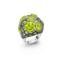 Haute Couture ring in 18kt white gold with peridots, black sapphires and tsavorites. DETAILS Peridots: - Weight (total): 8.12 CT - Cut: round brilliantBlack Sapphires:- Weight (total): 5.89 CT- Cut: round brilliantTsavorites:- Weight (total): 3.23 CT- Cut: round brilliant Being a handmade product the above characteristics may be subject to slight variations.