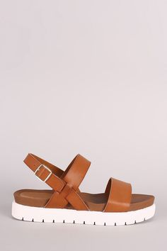 """Description This lug sole , lightly cushioned insole, and adjustable ankle strap with side buckle fastening. Material: Vegan Leather (man-made) Sole: Treaded Measurement Heel Height: 1.35"""" w/ 1.25"""" Pl"""