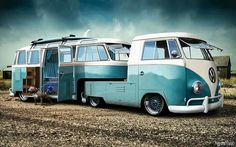 VW vans made into a tow-behind camper trailer & hauler.
