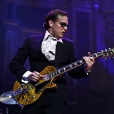 Joe Bonamassa.  The best blues guitarist you've never heard of.  If you like Stevie Ray Vaughn, you'll love Joe.
