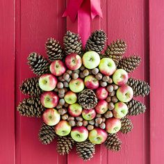 Green-and-red apples on this unusual Christmas wreath make it pop with color. Cover a 9-inch foam circle with green sheet moss (available at...