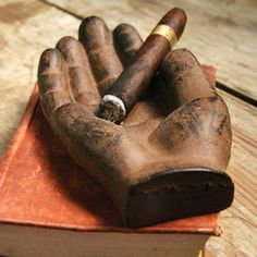 Keep the cigar, pass the hand!  Cast Iron Hand