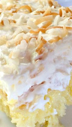 Pina Colada Cake ~ Heavenly poke cake recipe that's filled with lots of coconut flavor, the cake is moist, delicious and wonderful... Color the coconut on top with holiday colors if desired.