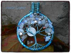Chiaro di luna - Albero della vita - Filo azzurro in due tonalità, scaglie di pietra di luna, perline in vetro, stelle in argento tibetano e luna in madreperla. StarLight - Tree of Life - Light blue wire, moonstone chips, glass beads, tibetan silver stars. It has a beautiful moon that gently flashes blue and pink .  _While these make beautiful pendants, never forget you can use them for many other things, dangling from a rear view mirror or as a decoration placed anywhere would be wonderful…