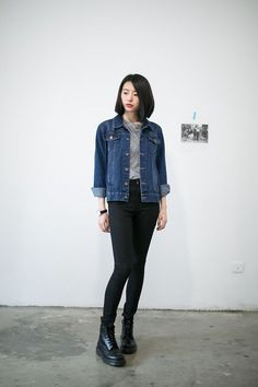 Shop this look on Lookastic:  http://lookastic.com/women/looks/grey-crew-neck-t-shirt-navy-denim-jacket-black-skinny-jeans-black-boots/7899  — Grey Crew-neck T-shirt  — Navy Denim Jacket  — Black Skinny Jeans  — Black Leather Boots