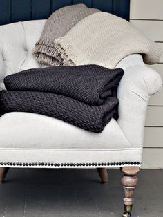 Image result for cream knit throw on a linen chair