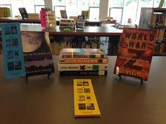 On display: books like THE MARTIAN and THE INFINITE SEA.