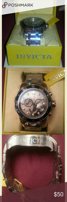 Invicta Mens Watch Model # 80059  Model Year: 2011 Swiss Quartz Movement Brand New. Still in case with warranty & original paperwork.  Flame fusion crystal stainless steel.  Water Resistant.  Excellent Condition. Invicta Accessories Watches