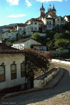 Ouro Preto is a city in the state of Minas Gerais, Brazil, a former colonial mining town located in the Serra do Espinhaço mountains and designated a World Heritage Site by UNESCO because of its outstanding Baroque architecture. (V)