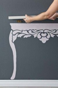 Paint a table and hang a floating shelf; perfect for a narrow space or a little girls room