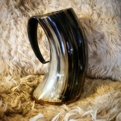 These are real, drinking horn mugs, also known as horn tankards. This style sports an extra sturdy wood base that looks a zillion good!  Made from genuine bovine horns, and lined with a food-safe sealant, they are the perfect drinking vessel for many occasions! Not only will they make you feel like a glorious knight or maiden of old, they are great conversation starters. Just having a medieval tankard will wow everyone at your favorite drinking hole and at your next party, or event! Being…