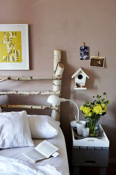 Interesting birch tree headboard. I love to use birch for decorating. It is a Grace style.