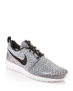 Simple and streamlined, these Roshe One sneakers from Nike give you a light, streamlined feel so you can focus on your workout. | Polyester/spandex/rubber/foam/synthetic plastic | Imported | Simplifie