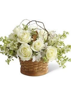 A small and simple basket design filled to the brim with white roses, larkspur, and alstromeria.