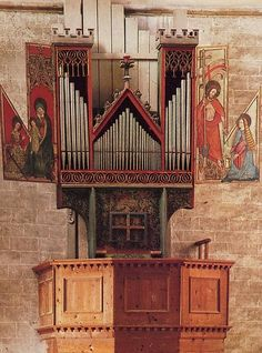 """With 12 of its pipes dating from around 1435, the oldest playable pipe organ in the world is located at the fortified Basilica of Valère in Sion, Switzerland. The organ's pipes were arranged to form a rough outline of a church; the larger ones forming two towers, and the smaller ones creating a triangular church roof. Very sweet."""