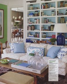 I like the pull of color to the cushions and other pieces.....    painted bookshelves