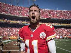 Kansas City Chiefs quarterback Alex Smith (11) celebrated after watching the…