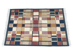 Unique wool on cotton, hand-woven geometric Indian Dhurrie rug. Reversible with variations of navy, rust, beige, mauve, and gold. Lovely geometric design would go well with so many different decor styles.