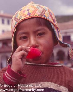 This travel photography portrait essay depicts children from around the world. Respectively a boy from Cusco, Peru eating a ice pop. A smiling girl from Egypt. Aboy ...