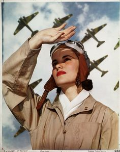 Soldiers of the Sky, Nickolas Muray. Nicolas Muray was a Hungarian born American portrait photographer and Olympic fencer who had a 10 year relationship with the artist Frida Kahlo. He produced this vibrant wartime propaganda image for Vogue. Images Aléatoires, Nickolas Muray, Female Pilot, Steve Mccurry, Nose Art, Ansel Adams, Aviation Art, Dieselpunk, Pin Up Art