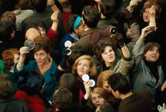 Women use compact mirrors in packed crowd to catch sight of the queen, 1966